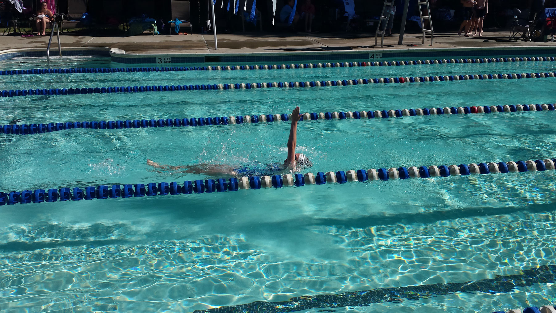 Swimmer racing in lanes