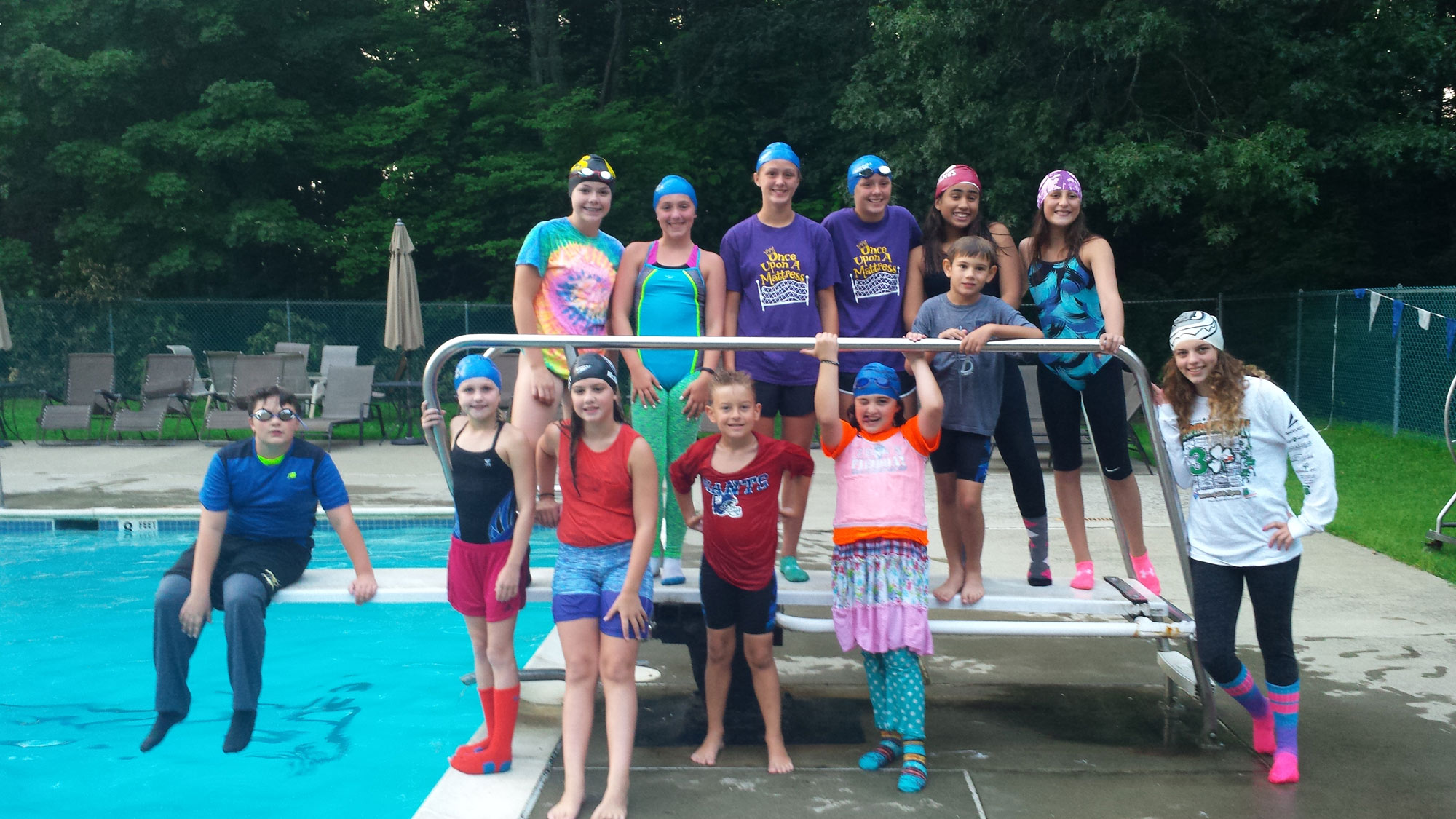 Hurely Rec Swim Team posing by the diving board