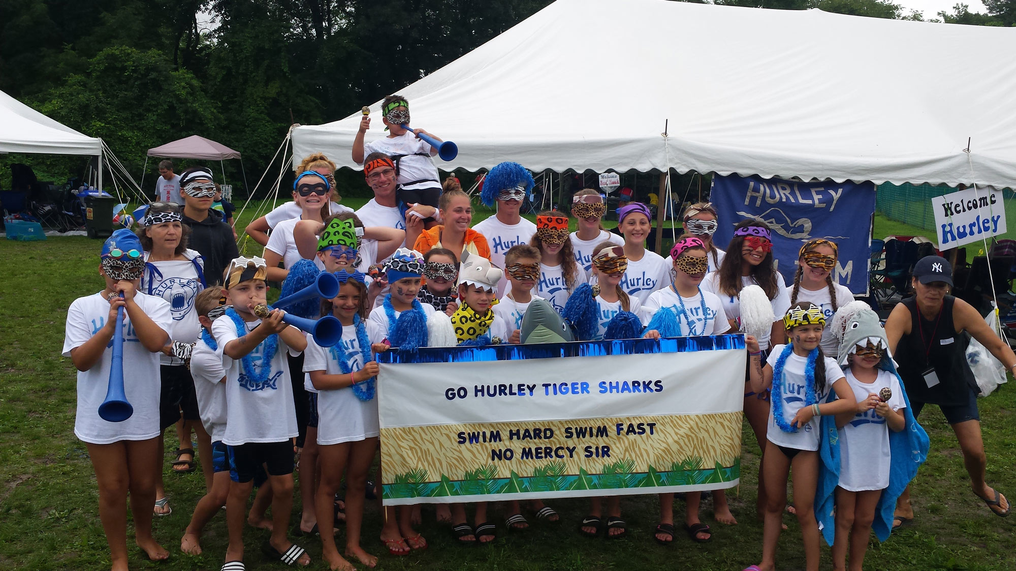 Hurely Rec Swim Team holding Banner